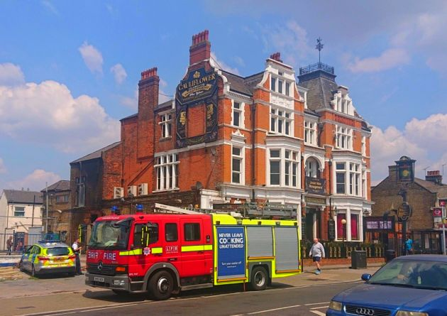 Firefighters tackled a blaze at the Cauliflower Pub in Ilford.