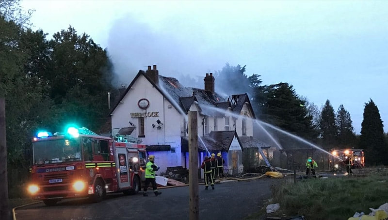 Fire destroyed the roof of The Cock Inn.