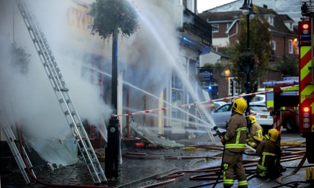 Firefighters tackle the serious fire at the Cycle King shop on Angel Hill in Bury St Edmunds.