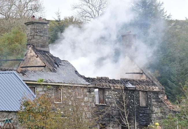 Smoke billows from the collapsed Rhiw Goch Inn roof in Trawsfynydd