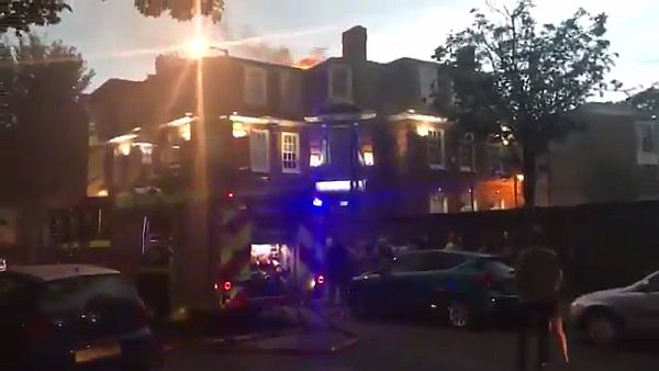 Fire visible on the roof of Grove House Pub causing damage to the 1st and 2nd floors.