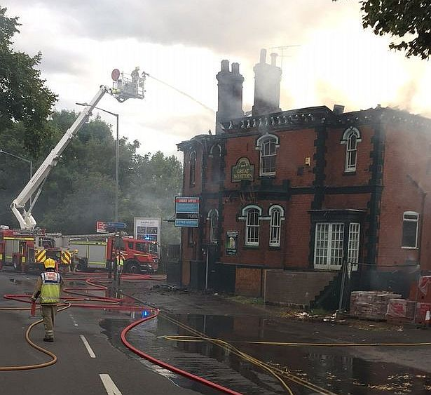 Firefighters deal with the blaze at the Great Western Pub.