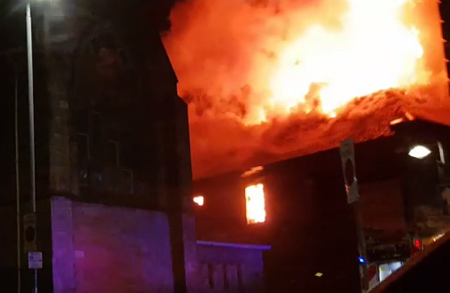 Image shows huge blaze ripping through building