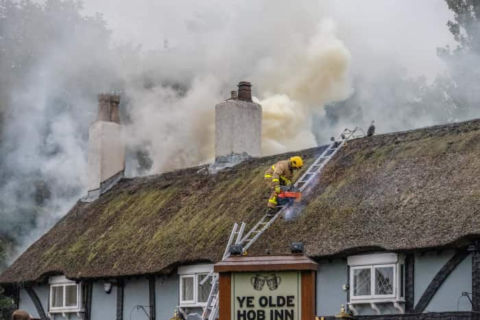 Firefighters tackle the blaze at Ye Olde Hob Inn.