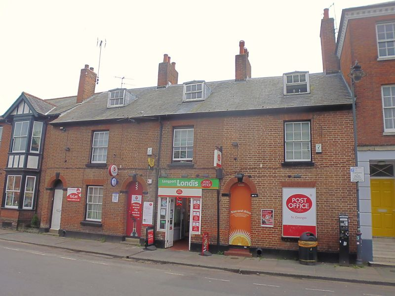 The shop, together with the attached house, are Grade II listed