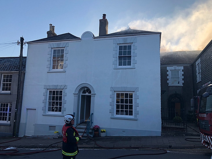Firefighters at the large Georgian house in Modbury, South Hams, Devon.