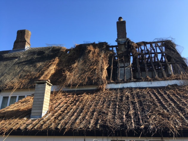 Fire ripped through the thatch at one end of the farmhouse leaving the beams totally exposed.