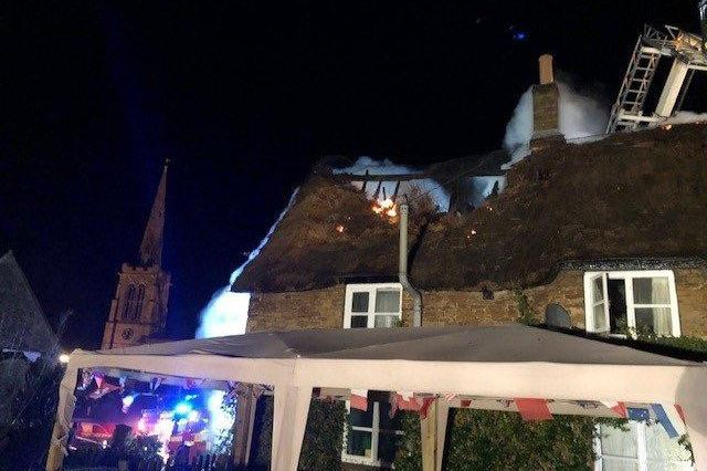Firefighters tackle the fire in the Grade II listed thatched building