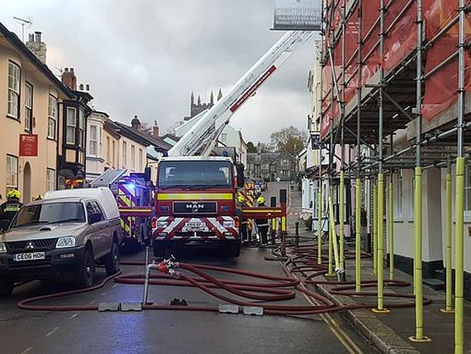 Firefighters use an aerial platform to tackle the fire