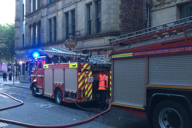 Firefighters responding to the incident at Caffe Grande, near Albert Square