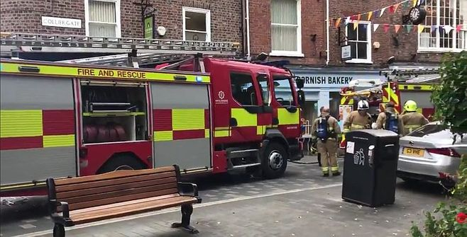 Homes and businesses in York city centre have been evacuated after a fire above a bakery.
