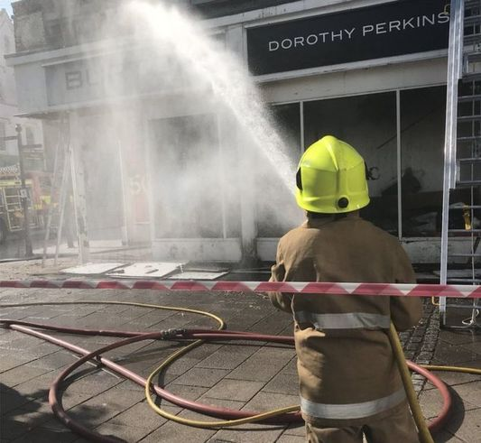 Photographs posted on Police Scotland's social media feeds show the shop was badly damaged in the fire.