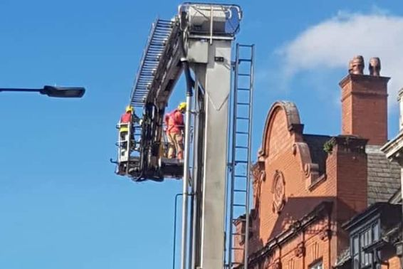 Firefighters using aerial equipment to tackle the blaze.
