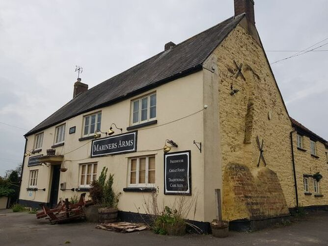 A man has been arrested on suspicion of arson following a fire at the Mariners Arms in Berkeley.