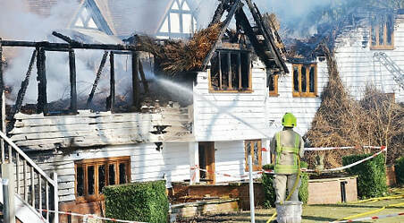 The thatched parts of the premises were severely damaged by fire.