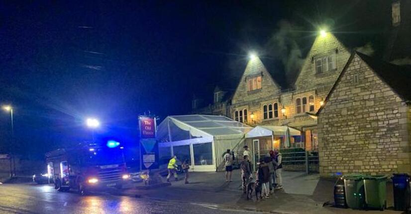 The roof ablaze at The Fleece Inn.