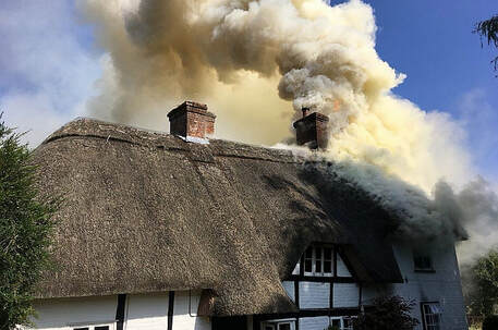 The thatched roof was fully alight when crews arrived