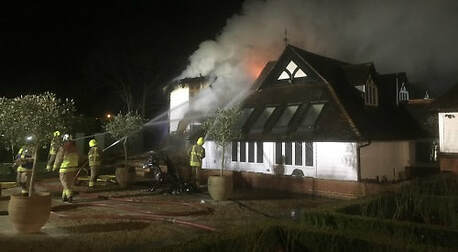 Six fire crews from two counties were sent to tackle a massive blaze at a thatched home in Goring.