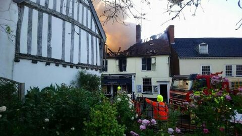 The fire is believed to have started in a flat above a shop