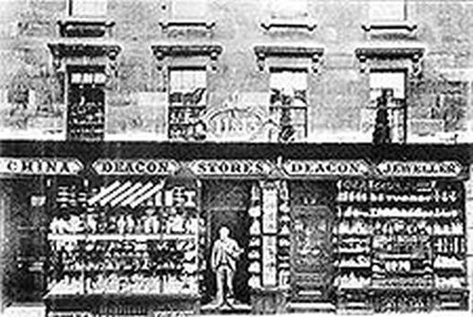 Photograph of the Wood Street shop front as it was in 1902 with Hubert Deacon standing in the doorway.