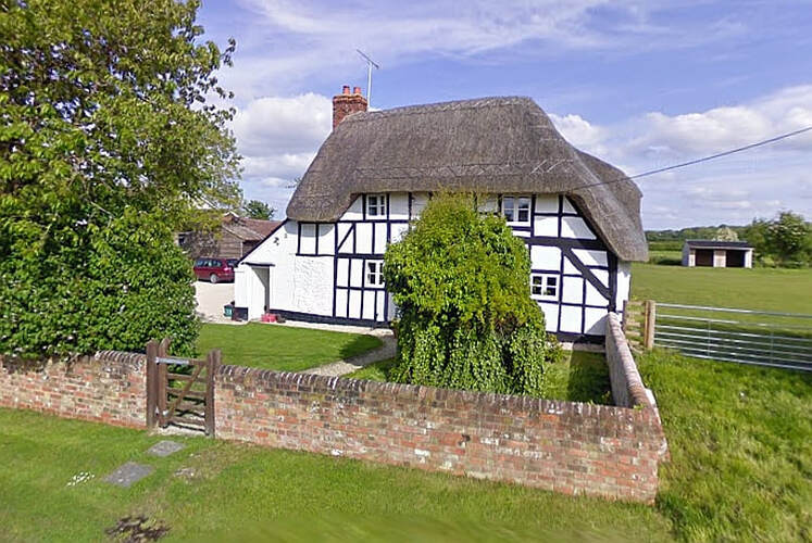The pretty cottage before the fire (Credit: Google)