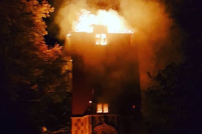 The fire was contained to the historic water tower