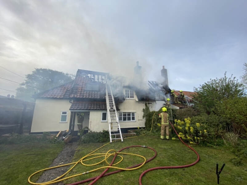 The fire tore through the roof of a thatched home in Stoke Ash Picture: IXWORTH FIRE STATION/SUFFOLK FIRE AND RESCUE SERVICE
