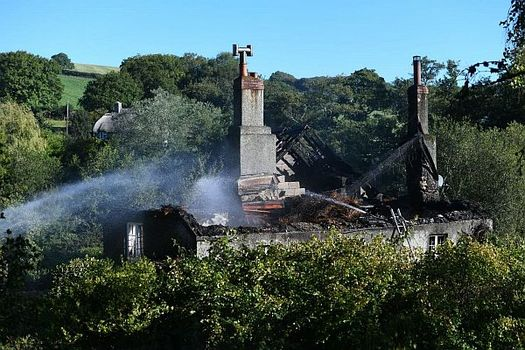 The fire burned for around 12 hours at the thatched roof property in Holbeton