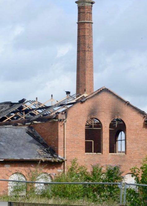 The damaged roof of the building after the fire