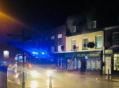 Smoke can be seen from the second floor in the early hours of the morning.