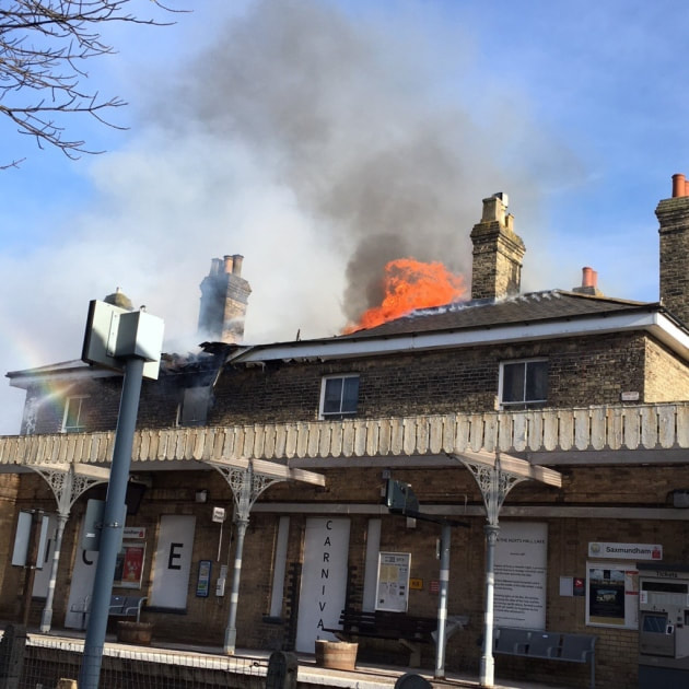 Firefighters tackle the blaze at Saxmundham Railway Station.