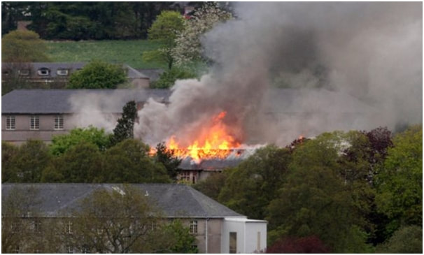 The roof of the Strathmartine Hospital  well alight again.