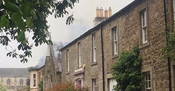 Smoke visible from the roof of the listed building at The Sands
