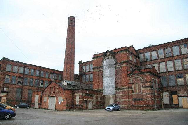A major blaze at a former Wigan cultural landmark is being investigated as arson.